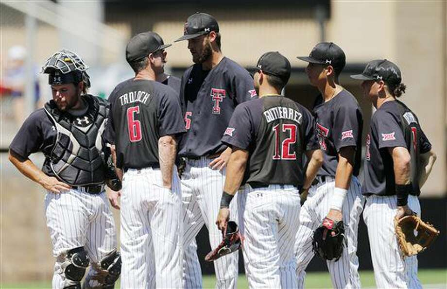 Texas Tech coach Tim Tadlock has a meeting on the mound after Texas Tech pitcher Hayden Howard gave up a home run during an NCAA college baseball regional game against Dallas Baptist Monday, June 6, 2016, in Lubbock. (Mark Rogers/Lubbock Avalanche-Journal via AP) Photo: Mark Rogers | Lubbock Avalanche-Journal Via AP