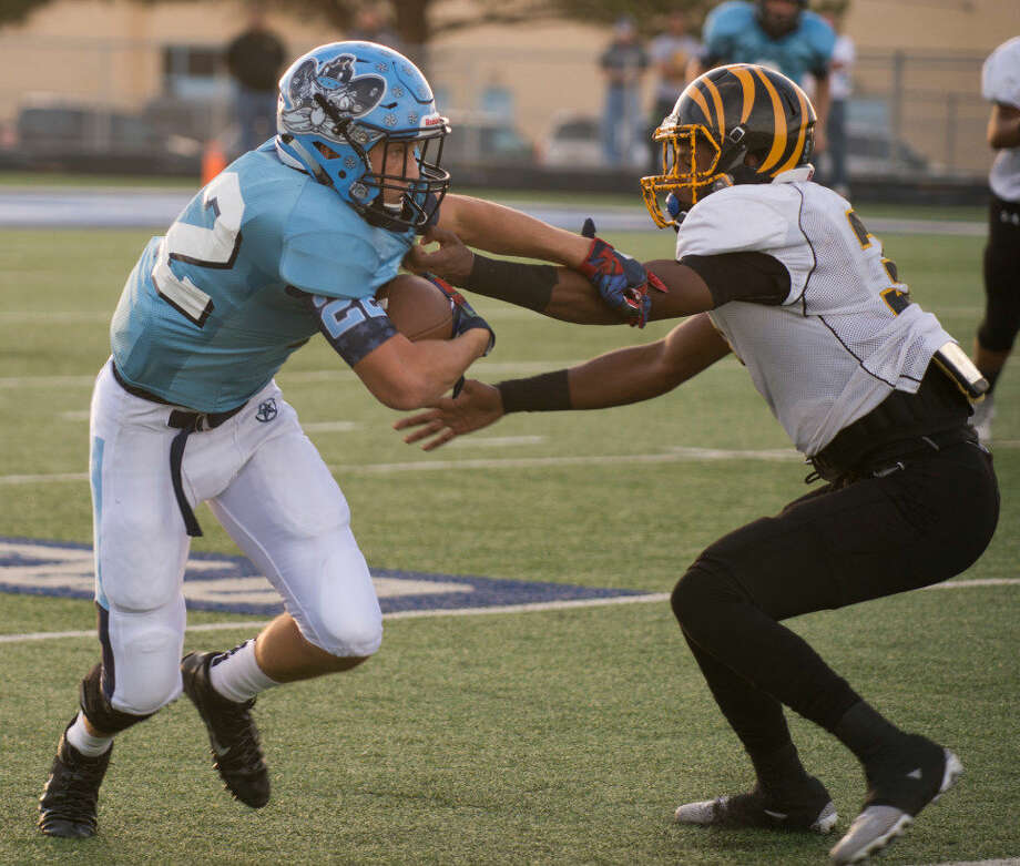 Greenwood's Hunter Wigington (22) fights for yards against Snyder in game at J.M. King Memorial Stadium on Aug. 26. Tim Fischer | Reporter-Telegram Photo: Tim Fischer | Reporter-Telegram