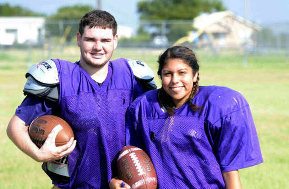 In this Aug. 10, 2016 photo, Harrold High School senior Brady Blakely, left, stands with teammate Olivia Perez in Harrold, Texas. Blakely is the primary reason Perez decided to try and help the Harrold High football team salvage their season. Blakely wanted to have one last year to play football to honor his father, who passed away from cancer last November. The team needed six players to compete and only had five before Perez. (Chance Baskerville/Vernon Daily Record via AP) Photo: Chance Baskerville