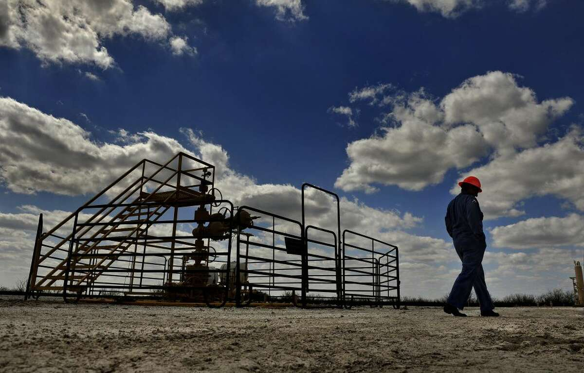 Swift Energy chief Terry Swift walks the grounds at a company drilling site in Tilden, Texas, in March.