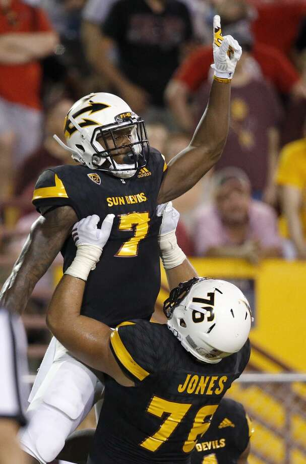 Arizona State's Kalen Ballage (7) celebrates a touchdown against Texas Tech with Sam Jones, right, during the first half of an NCAA college football game Saturday, Sept. 10, 2016, in Tempe, Ariz. (AP Photo/Ross D. Franklin) Photo: Ross D. Franklin