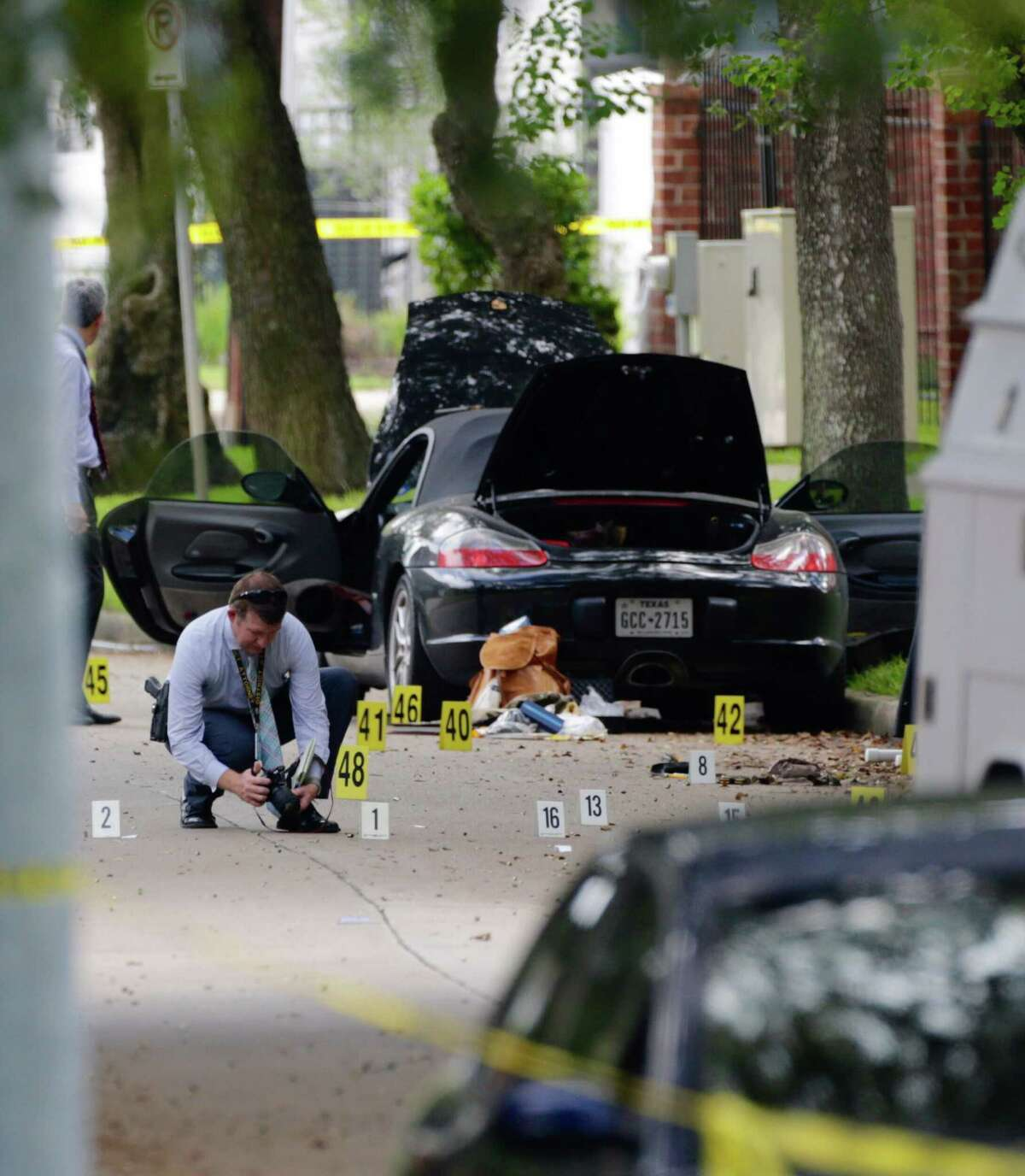 Police investigate the suspect's car in Monday morning's shooting along Law Street at Weslayan, Sept. 26, 2016.