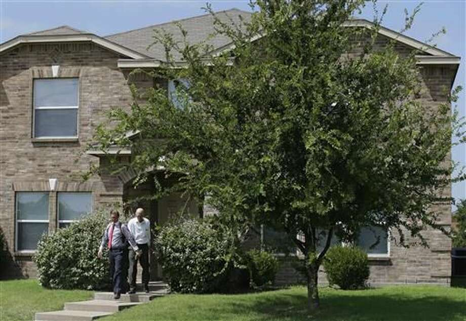 Investigators leave the home of Micah Xavier Johnson in the Dallas suburb of Mesquite, Texas, Friday, July 8, 2016. A Texas law enforcement official identified Johnson, 25, as the sniper who opened fire on police officers in the heart of Dallas during protests over two recent fatal police shootings of black men. (AP Photo/LM Otero)