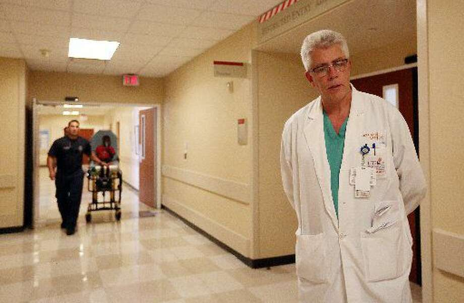 Dr. John Holcomb, Director of the Texas Trauma Institute at Memorial-Hermann, walks through trauma center on Tuesday, July 7, 2015, in Houston. ( Mayra Beltran / Houston Chronicle )