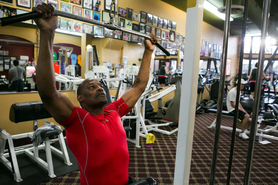 Mark Bryant, who lives in Seattle's works on lat pulls at Columbia City Fitness, where he teaches. Photo: Seattle Times/TNS