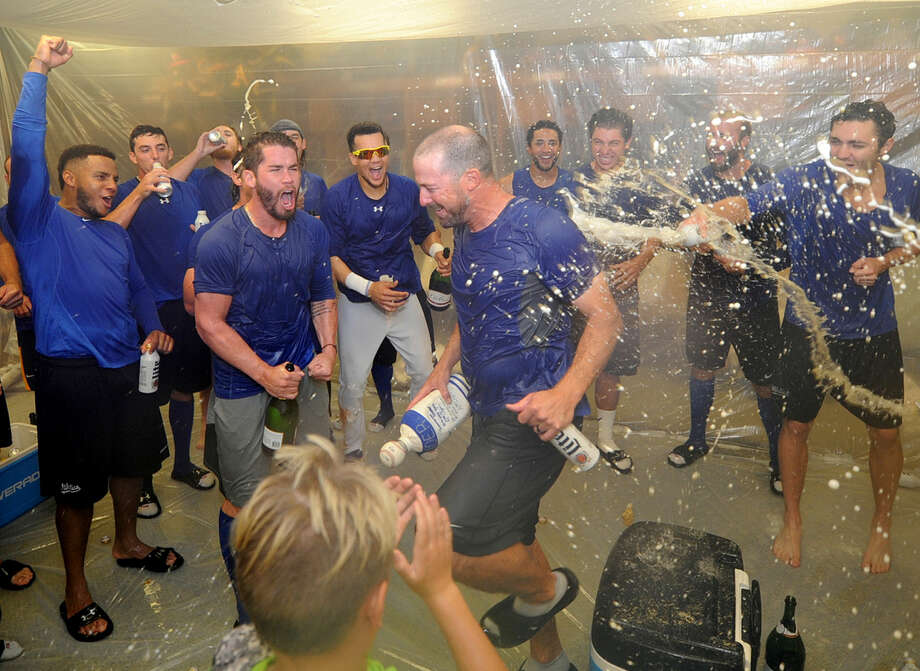 RockHounds manager Ryan Christenson is doused with champaign after clinching the Texas League Division playoff series in four games against Corpus Christi on Saturday, Sept. 10, 2106, at Security Bank Ballpark. James Durbin/Reporter-Telegram Photo: James Durbin