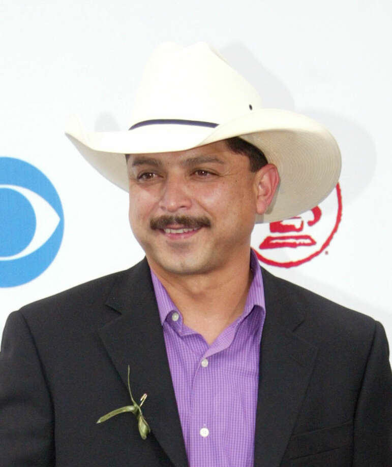 In this Sept. 3, 2003 file photo, Emilio Navaira arrives at the Latin Grammy Awards in Miami. The Grammy-winning Tejano star has died in New Braunfels, Texas. He was 53. Police in New Braunfels said in a statement Tuesday, May 17, 2016, that preliminary results indicate the entertainer died of natural causes. (AP Photo/Wilfredo Lee, file) Photo: AP