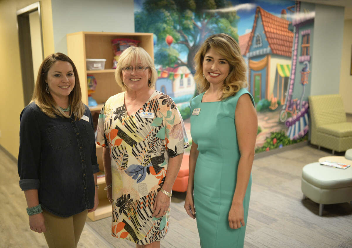 From left, Kayla Minchew, Executive Director Charlotte Bosecker and Melanie Saiz, inside MARC's new Spectrum of Solutions facility near the intersection of West Illinois and Plaza in this 2016 photo.