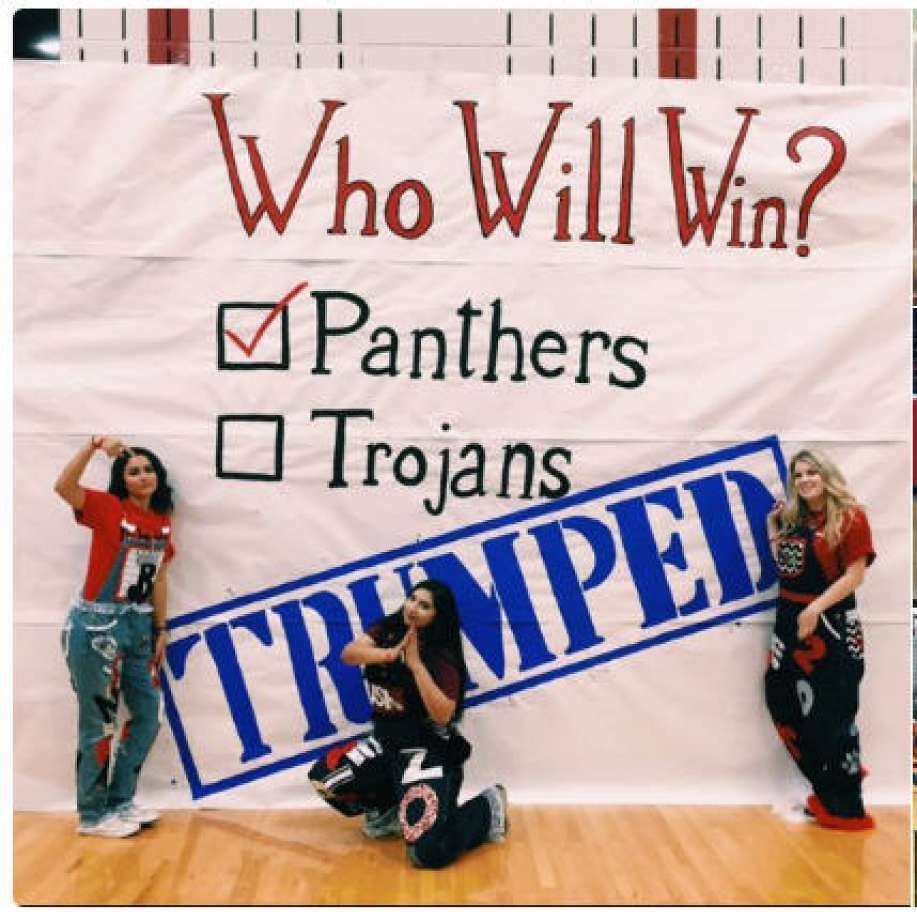 A sign at a a pep rally before the Colleyville Heritage High School and Trinity High game Friday night, Sept. 9. 2016. It was one of several to reference a border wall between the United States and Mexico and spark outrage on Twitter. Click through to see more about the controversy. Photo: Photo: Twitter
