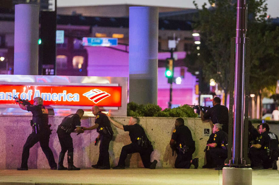 Dallas Police respond after shots were fired at a Black Lives Matter rally in downtown Dallas on Thursday, July 7, 2016. Dallas protestors rallied in the aftermath of the killing of Alton Sterling by police officers in Baton Rouge, La. and Philando Castile, who was killed by police less than 48 hours later in Minnesota. (Smiley N. Pool/The Dallas Morning News) Photo: Smiley N. Pool