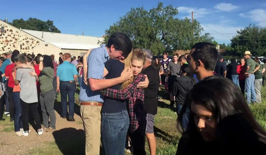 In this image made from a video by KWES-TV, people gather near the Alpine High School school campus after a shooting, in Alpine, Texas, Thursday, Sept. 8, 2016. A female student died of an apparent self-inflicted gunshot wound Thursday after shooting and injuring another female student inside the high school in West Texas, according to the local sheriff. (KWES-TV via AP) Photo: TEL