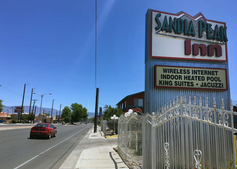 This Wednesday, July 13, 2016 photo shows the Sandia Peak Inn in Albuquerque, N.M., one of many motels along the historic Route 66 installing charging stations for electric cars. Route 66, a highway made famous for attracting gas-guzzling Chevrolet Bel Airs traveling from Chicago to Los Angeles, is seeing a growing number of electric car charging stations along the 2,500-mile path, and some states even are pushing for solar panels and electric buses. (AP Photo/Russell Contreras) Photo: Russell Contreras