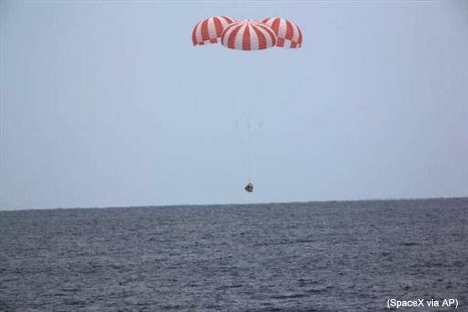 In this photo released by SpaceX, a SpaceX capsule containing science samples from NASA's one-year space station resident, approaches the Pacific Ocean, a few hundred miles off the Southern California coast, Wednesday, May 11, 2016. Nearly 4,000 pounds of items fill the Dragon, including blood and urine samples from astronaut Scott Kelly's one-year mission. Kelly returned to Earth in March and has since retired from NASA. Researchers will use the medical specimens to study how the body withstands long journeys in space, in preparation for an eventual mission to Mars in the 2030s. (SpaceX via AP) Photo: HONS