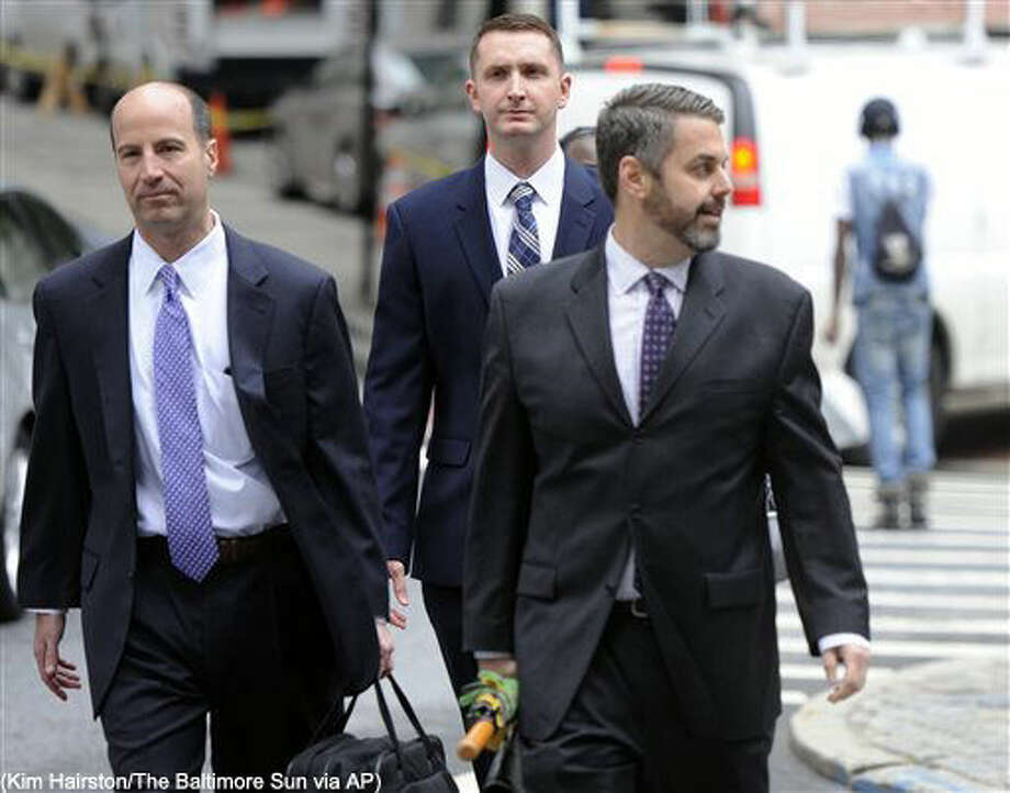 From left, attorney Marc Zayon, Baltimore Police Officer Edward Nero, and attorney Jason Silverstein, walk to Courthouse East before hearing on Tuesday, May 10, 2016 in Baltimore. A judge will rule on several motions ahead of the trial for Nero, one of the police officers charged in the death of Freddie Gray. Nero faces assault, reckless endangerment and misconduct in office. Gray died April 19, 2015, a week after suffering a critical spinal injury in the back of a police van. (Kim Hairston/The Baltimore Sun via AP) WASHINGTON EXAMINER OUT; MANDATORY CREDIT Photo: Kim Hairston