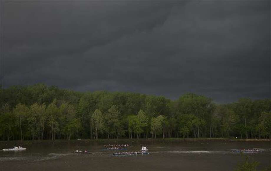 The Kansas University rowing team practices on the Kansas River under threatening clouds as a storm front moves over Lawrence, Kan. early Tuesday morning, April 26, 2016. (Mike Yoder/Lawrence Journal-World via AP) Photo: Mike Yoder
