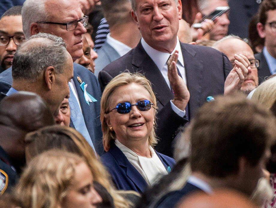 Democratic presidential candidate Hillary Clinton abruptly left the ceremony at the Sept. 11 memorial, in New York, Sunday, Sept. 11, 2016. Her physician said the incident was related to pneumonia and dehydration Photo: Associated Press