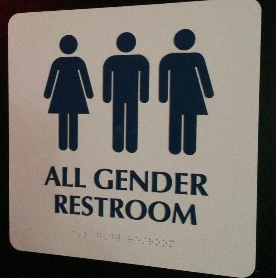 """This May 11, 2014 photo shows an """"All Gender Restroom""""signoutside abathroomin a bar in Washington. Confrontations have flared across the country over whether to protect or curtail the right oftransgenderpeople to use public restrooms in accordance with their gender identity. (AP Photo)"""