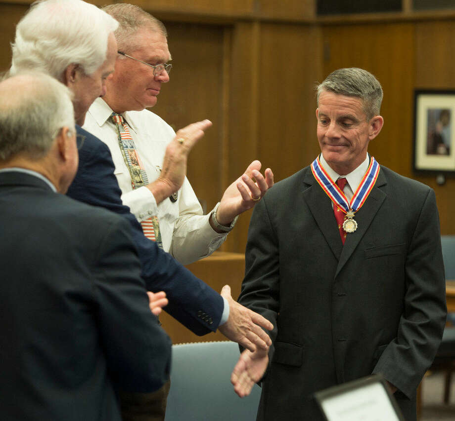 U.S. Marshal Steve Clark, right, is honored Thursday 08-11-16 with the Department of Justice's Federal Law Enforcement Congressional Badge of Bravery. Tim Fischer/Reporter-Tel­egram