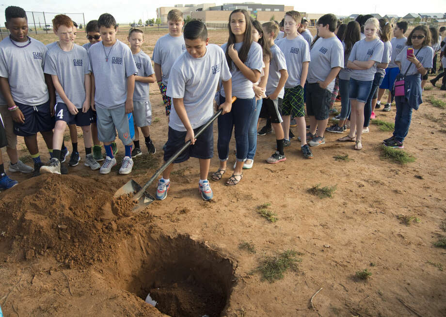 "Fasken Elementary sixth graders, the first to graduate from the school, bury a time capsule Friday 06-03-16 on campus. Students placed a yearbook, school t-shirt, today's newspaper and handwritten notes on ""My Favorites"" in the container. They plan to gather following their graduation in 2022 to open the time capsule. Tim Fischer\Reporter-Telegram Photo: Tim Fischer"