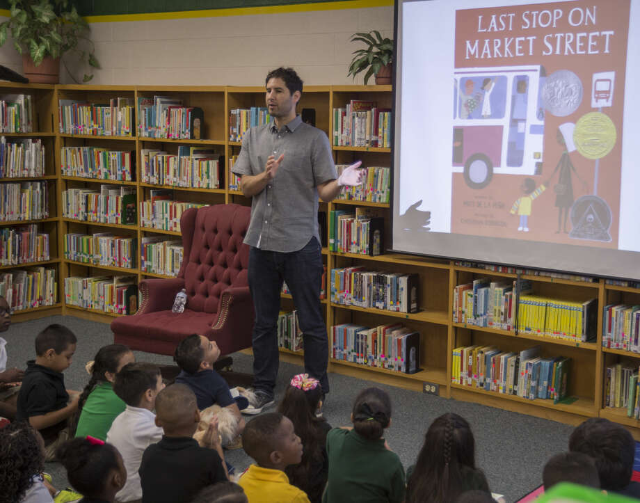 Author Matt De La Pena reads his book, Last Stop on Market Street, and talks about the story Monday 09-12-16 to Milam Elementary first graders as part of Project Literacy. Tim Fischer/Reporter-Telegram Photo: Tim Fischer