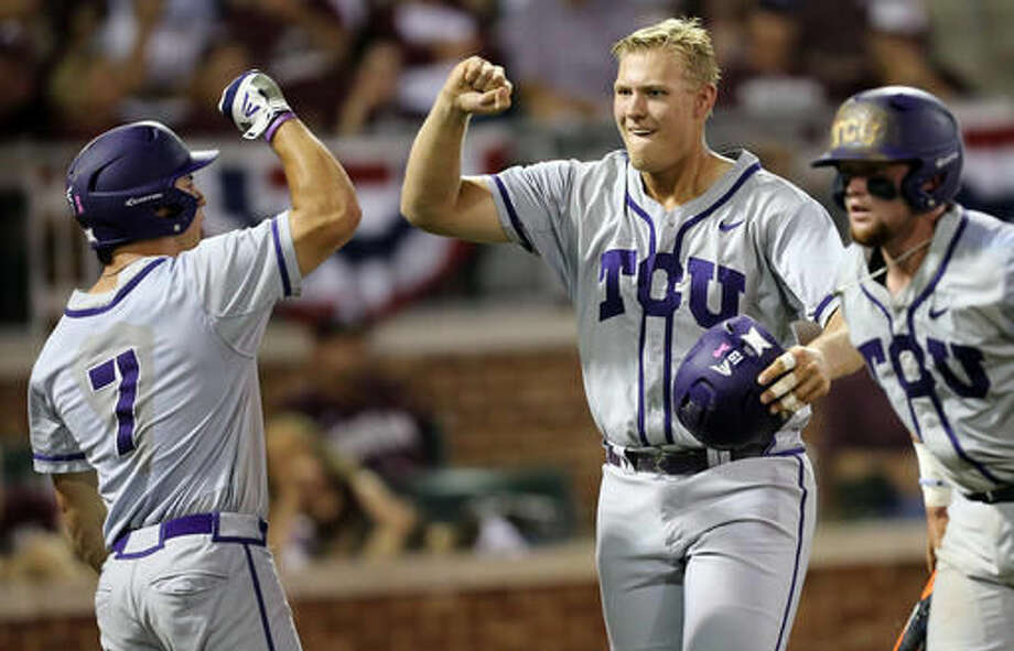 TCU's Luken Baker (19) celebrates with teammate Josh Watson (7) after a three-run homer against Texas A&M during the third inning of an NCAA Super Regional baseball tournament game, Friday, June 10, 2016, in College Station. (AP Photo/Sam Craft) Photo: Sam Craft | Associated Press