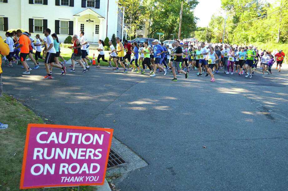And the 5K race was on for charity at the 29th annual Bigelow Tea Community Challenge, Sunday, Sept. 25, 2016, in Fairfield, Conn. Photo: Jarret Liotta / For Hearst Connecticut Media / Fairfield Citizen News Freelance