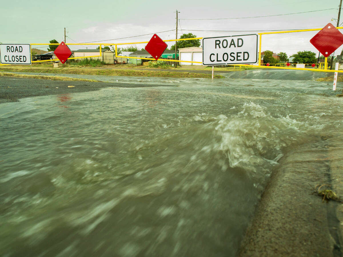 Rain showers Friday 08-12-2016 afternoon flooded Midland streets and filled Scharbauer Draw with rushing water. Photo by Tim Fischer/Midland Reporter-Telegram