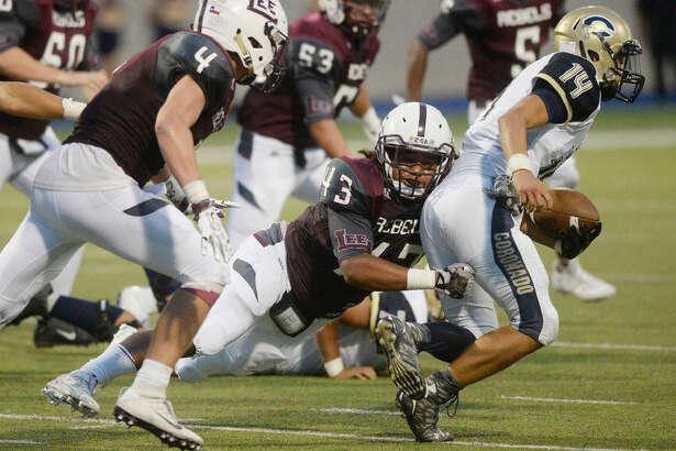 Lee's defensive lineman Isaiah Garza (43) sacks El Paso Coronado quarterback Angelo Donatelli (14) in the season-opening game Friday, August 26, 2016, at Grande Communications Stadium. James Durbin/Reporter-Telegram