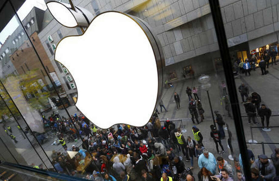 FILE - In this Friday, Sept. 25, 2015, file photo, people wait in front of the Apple store in Munich, before the worldwide launch of the iPhone 6s. On Tuesday, April 26, 2016, Apple reported that quarterly revenue fell for the first time in more than a decade, as iPhone sales fell compared with a year ago. That's putting more pressure on the world's most valuable public company to come up with its next big product. (AP Photo/Matthias Schrader, File) Photo: Matthias Schrader