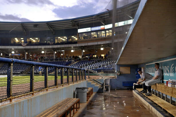 Northwest Arkansas players look on from the dugout during a rain delay before game four of the Texas League Championship series against the Midland RockHounds on Thursday, Sept. 15, 2016 at Security Bank Ballpark. James Durbin/Reporter-Telegram