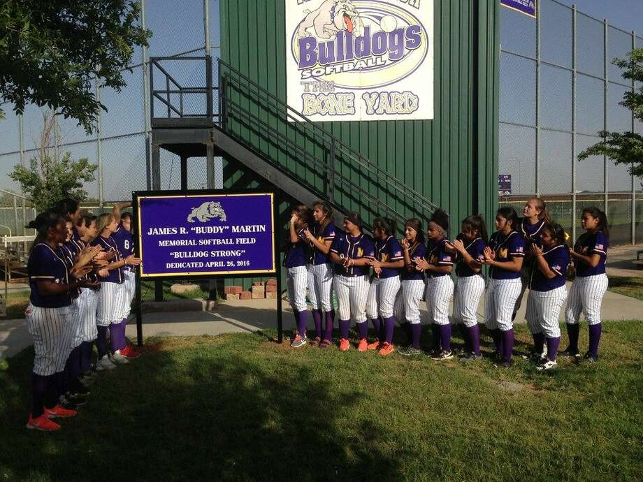 "The Midland High softball team applauds after unveiling a sign Tuesday to commemorate its varsity field in the memory of longtime Midland ISD groundskeeper James R. ""Buddy"" Martin. The field was renamed the James R. ""Buddy"" Martin Memorial Softball Field. Photo by Christopher Hadorn 
