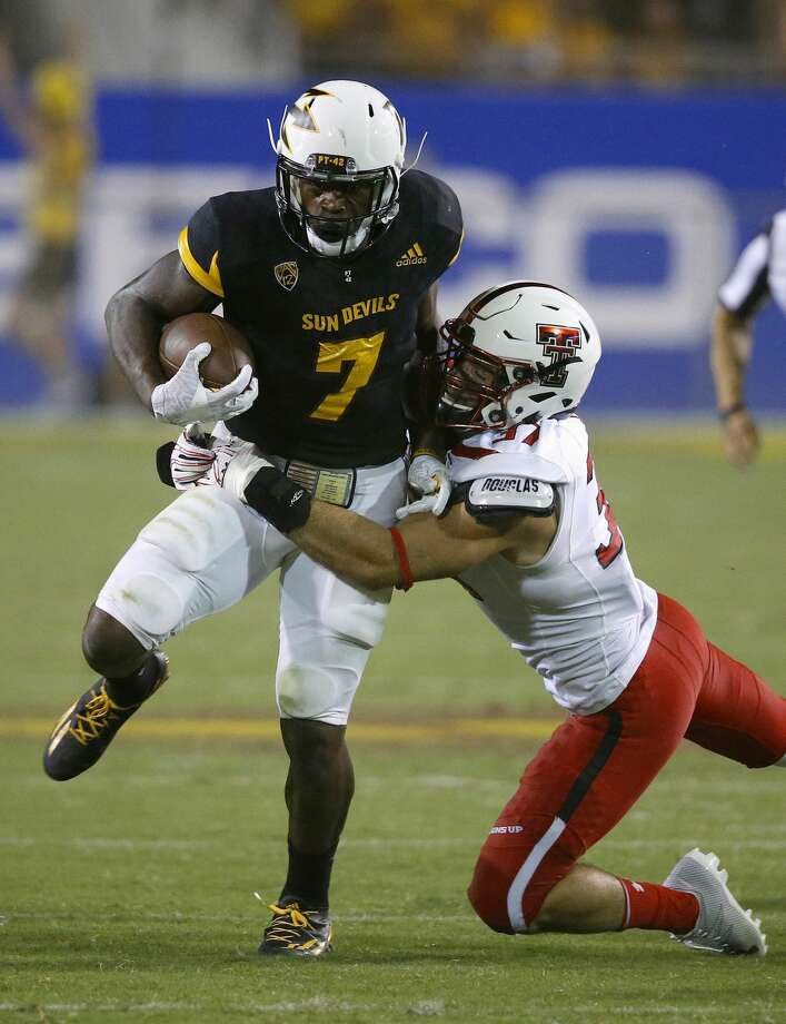 Arizona State's Kalen Ballage (7) runs with the ball as Texas Tech's Luke Stice, right, comes in for the tackle during the second half of an NCAA college football game Saturday, Sept. 10, 2016, in Tempe, Ariz. Arizona State defeated Texas Tech 68-55. (AP Photo/Ross D. Franklin) Photo: Ross D. Franklin