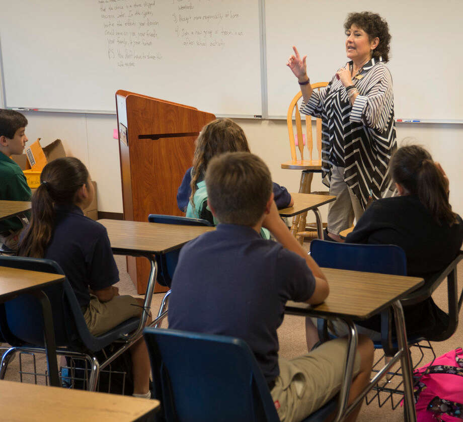 St. Ann's School counselor Cyndye Harrell speaks with 6th graders Tuesday 08-16-16 in one of the new portable buildings on campus. Tim Fischer/Reporter-Telegram