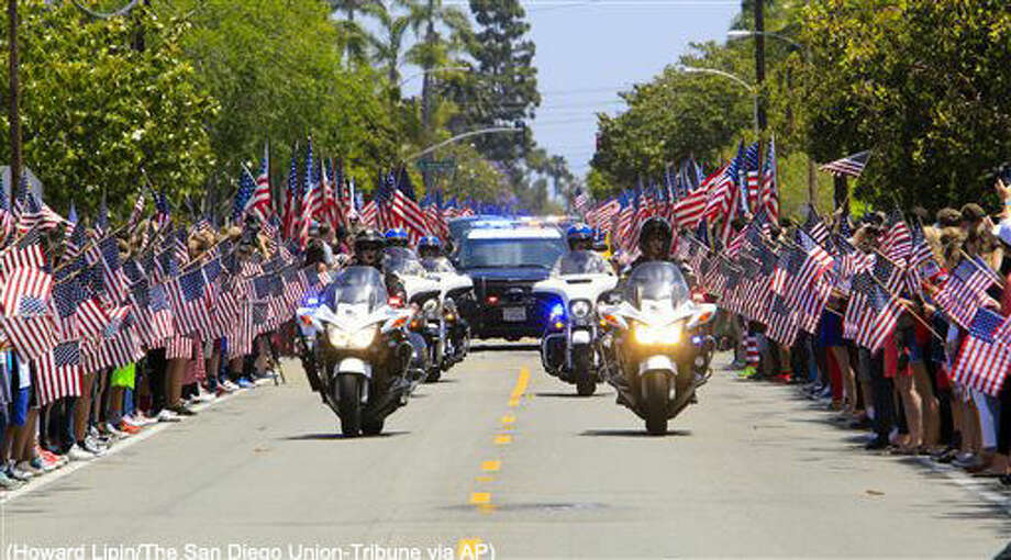 Coronado Police and California Highway Patrol officers lead the funeral for Navy SEAL Charles Humphrey Keating IV, killed in action on May 3, during an Islamic State attack near the city of Irbil in Iraq, as it travels down Sixth Street in Coronado, Calif., Friday, May 13, 2016. (Howard Lipin/The San Diego Union-Tribune via AP) Photo: Howard Lipin