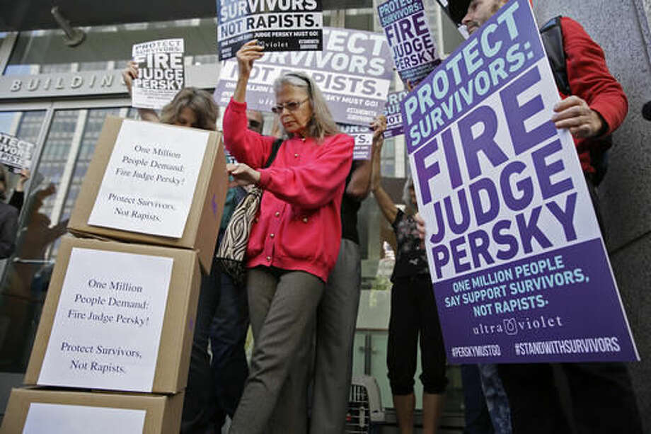 Activists from UltraViolet, a national women's advocacy organization, hold a rally before delivering over one million signatures to the California Commission on Judicial Performance calling for the removal of Judge Aaron Persky from the bench Friday, June 10, 2016, in San Francisco. A group of California lawmakers joined women's rights advocates Friday in urging a California agency to take action against the judge who sentenced a former Stanford University swimmer to six months in jail for sexually assaulting an unconscious woman. (AP Photo/Eric Risberg) Photo: Eric Risberg