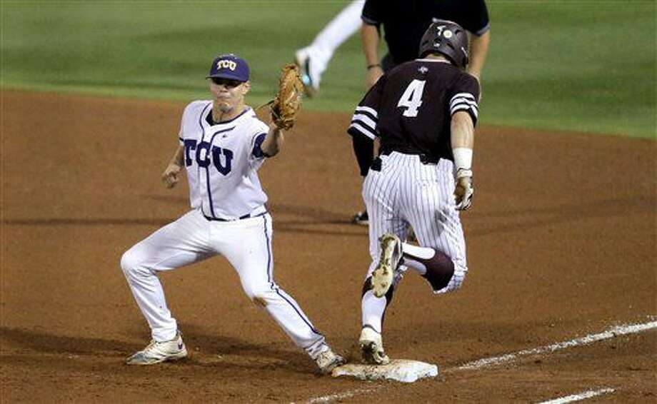 TCU's Connor Wanhanen (16) tags first base to put out Texas A&M's Nick Banks during the fourth inning of a NCAA college baseball Super Regional tournament game against TCU, Saturday, June 11, 2016, in College Station. Texas A&M won 7-1 to even the series at 1-1. (AP Photo/Sam Craft) Photo: Sam Craft | Associated Press