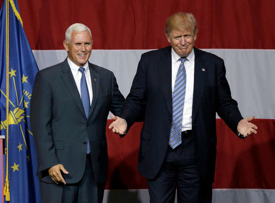 Indiana Gov.MikePencejoins Republican presidential candidate Donald Trump at a rally in Westfield, Ind., Tuesday, July 12, 2016. (AP Photo/Michael Conroy)
