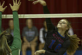 Midland Christian's Shayla Ellison attempts a kill as Monahans' Caylee Williams tries to block Tuesday 08-16-16 at the McGraw Events Center. Tim Fischer/Reporter-Telegram