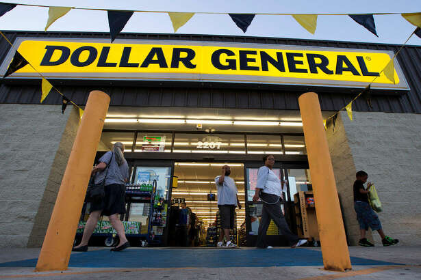 FILE - In this Wednesday, Sept. 25, 2013, file photo, customers exit a  Dollar    General  store, in San Antonio.  Dollar    General  reports financial results Thursday, March 10, 2016. (AP Photo/Eric Gay, File)