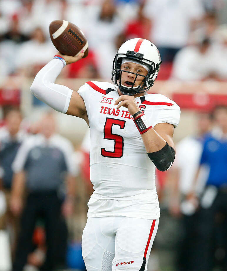 c0ab75ebde6 Texas Tech's Patrick Mahomes (5) looks to pass the ball during an NCAA  college