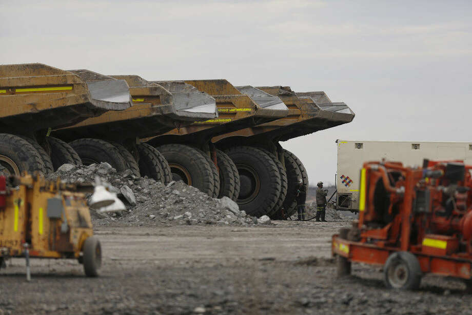 Workers refuel dump trucks at thePeabodyEnergyCorp. Somerville Central coal mine in Oakland City, Indiana, U.S., on Wednesday, April 6, 2016.Peabodyfiled for bankruptcy on Wednesday, the most powerful convulsion yet in an industry that's still waiting for the coal market to bottom out. Photographer: Luke Sharrett/Bloomberg Photo:  Photographer: Luke Sharrett/Bloomberg