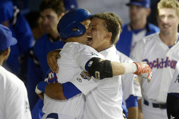 RockHounds' Viosergy Rosa (left) is congratulated by teammate Yairo Munoz (right) in the dugout after hitting a home run against Northwest Arkansas in game four of the Texas League Championship series on Thursday, Sept. 15, 2016 at Security Bank Ballpark. James Durbin/Reporter-Telegram