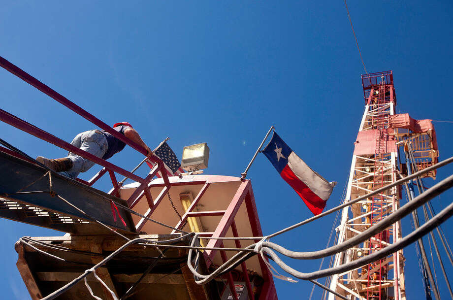 A driller is seen onboard Robinson Drilling rig No. 4 earlier this year in Midland County. Pioneer Natural Resources Chairman and CEO Scott Sheffield predicts that the Permian will add 100 rigs over the next year. Photo: MRT File Photo