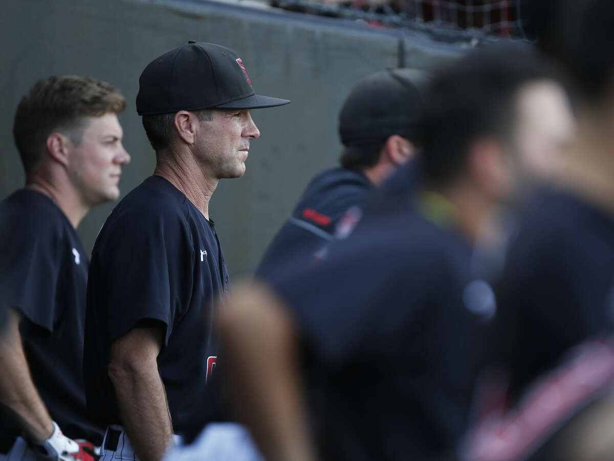 Texas Tech coach Tim Tadlock watches his team from the dugout during an NCAA college baseball tournament super regional game against East Carolina, Friday, June 10 in Lubbock. (Brad Tollefson/Lubbock Avalanche-Journal via AP)