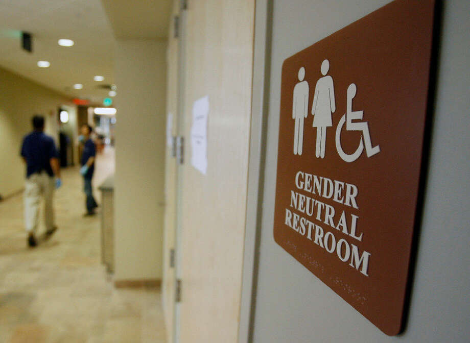 In this file photo, a sign marks the entrance to a gender-neutral restroom at the University of Vermont in Burlington, Vt.