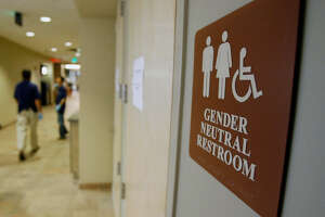 FILE- In this Aug. 23, 2007, file photo, a  sign  marks the entrance to a gender-neutral restroom at the University of Vermont in Burlington, Vt. Nearly all of the nation's 20 largest cities, including New York City, have local or state nondiscrimination laws that allow  transgender  people to use whatever  bathroom  they identify with, though a debate has raged around the topic nationwide. Bill de Blasio, a Democrat, signed an executive order on Monday, March 7, 2016, that guarantees people access to single-sex facilities consistent with their gender identity at city facilities, including offices, pools and recreation centers, without the need to show identification or any other proof of gender. (AP Photo/Toby Talbot, File)