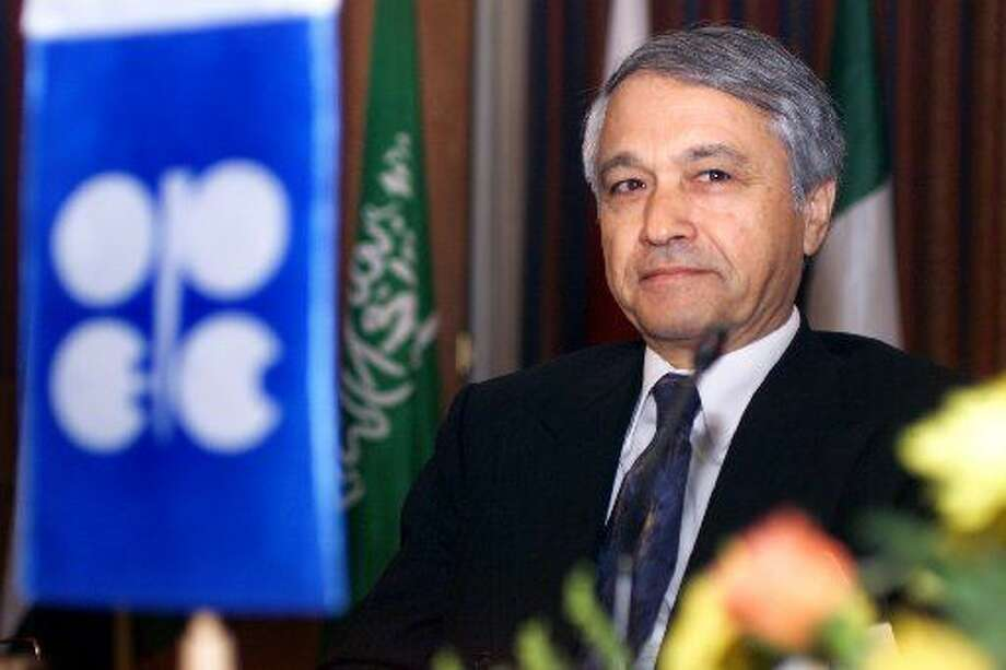 Former OPEC chiefChakibKhelilfrom Algeria poses as he chairs the extraordinary meeting of Ministers of the Organization in Cairo Friday, Dec. 28, 2001. (AP Photo/Amr Nabil)