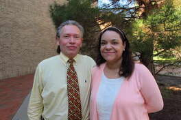 In a photo taken Sept. 9, 2016, William A. and Claire Rembis stand outside the Texas Tech University Law School in Lubbock, Texas. The couple is trying to regain custody of their 11 children after Texas child welfare officials took custody of them following allegations that include some of the children going into garbage bins to get scraps of food to eat. (AP Photo/Betsy Blaney)