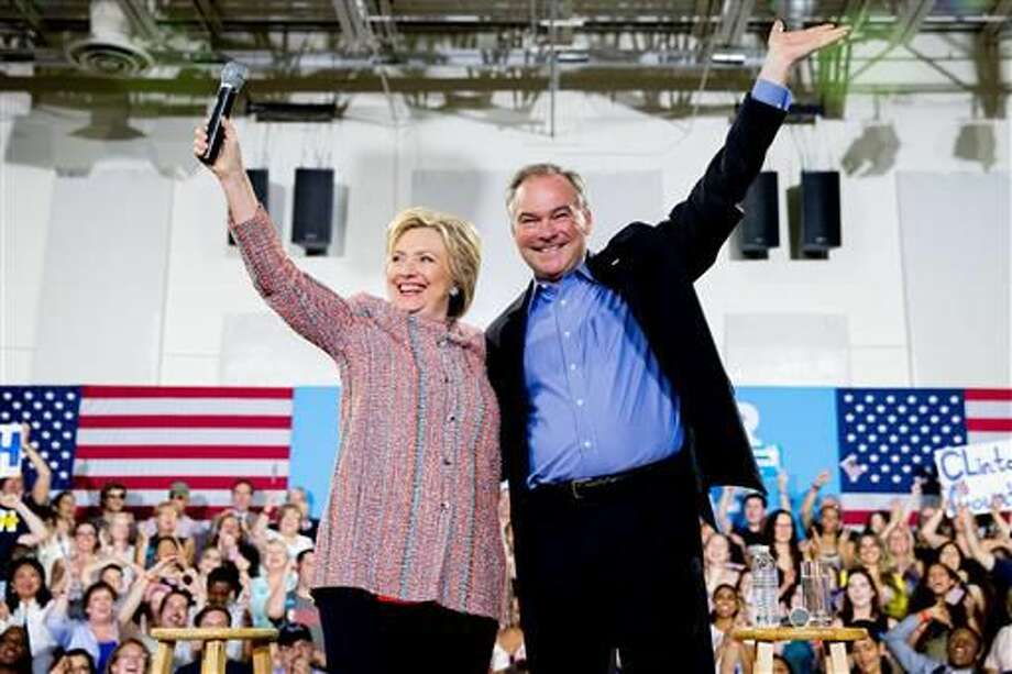 In this July 14, 2016, file photo, Democratic presidential candidate Hillary Clinton, accompanied by Sen. Tim Kaine, D-Va., speaks at a rally at Northern Virginia Community College in Annandale, Va. Kaine has been rumored to be one of Clinton's possible vice president choices. (AP Photo/Andrew Harnik)