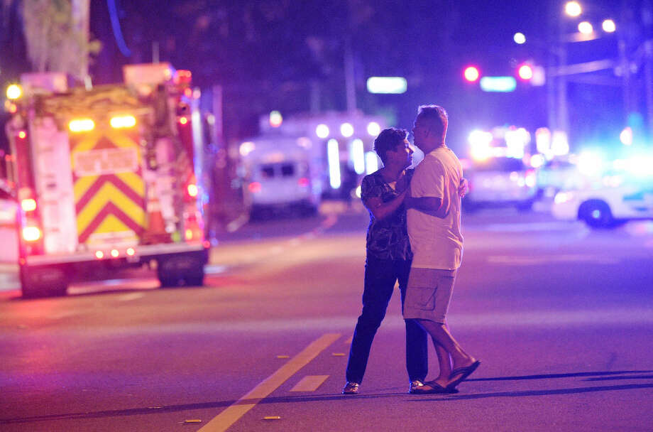 Family members wait for word from police after arriving down the street from a shooting involving multiple fatalities at Pulse Orlando nightclub in Orlando, Fla., Sunday, June 12, 2016. (AP Photo/Phelan M. Ebenhack) Photo: Phelan M. Ebenhack